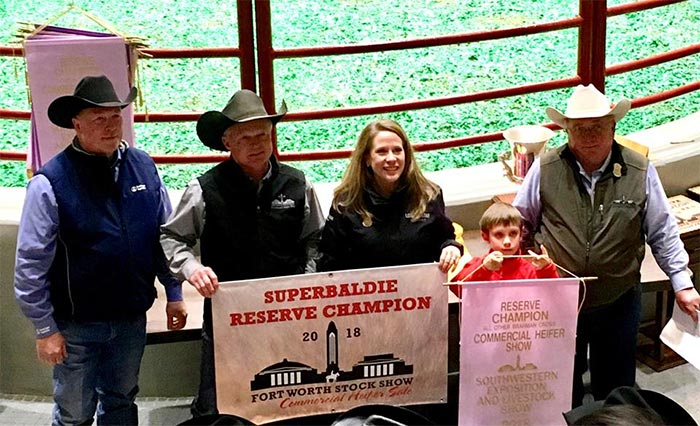 Fort Worth Stock Show Commercial Heifer Sale Reserve Champion receiving award. sponsored by Lone Star Ag Credit.