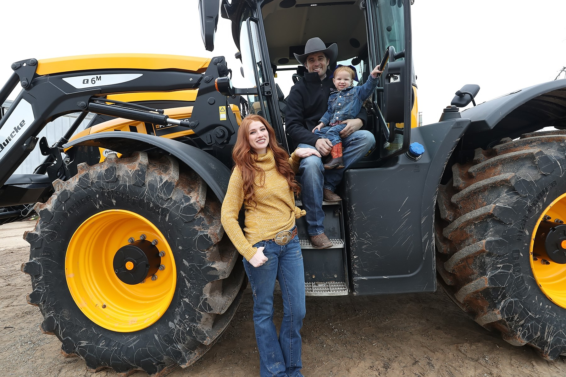 Lone Star Ag Credit customers, Hamish and Courtney Harley with daughter on tractor.