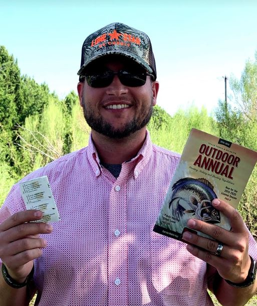 Adam Ledlow with hunting license