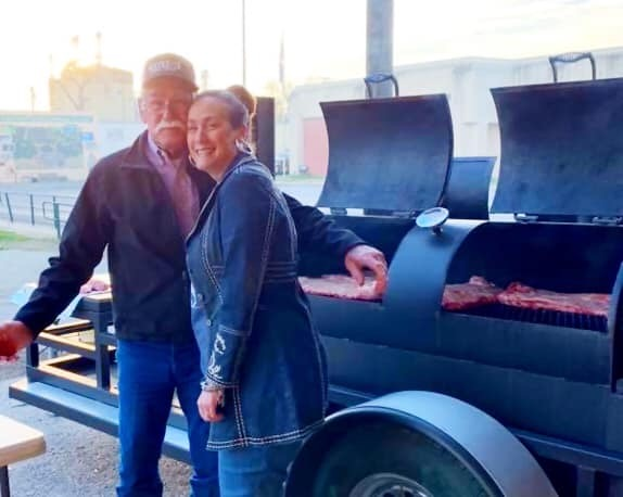 Lone Star Ag Credit, Lampasas office president, Macy Blankenship at cookout with guest.