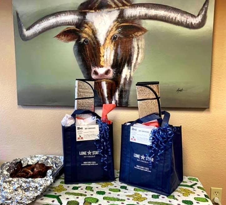 Lone Star Ag Credit gift bags on table.